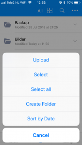 Select Upload in the pop-up menu in the Amazon Drive iOS app